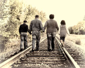 Family portrait walking along tracks